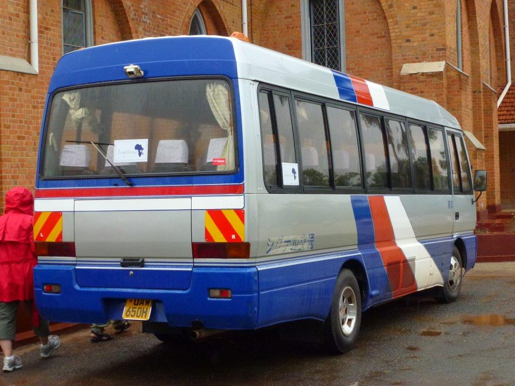 Boarding Jewelines Bus at Namirembe Cathedral during Kampala City Tour.